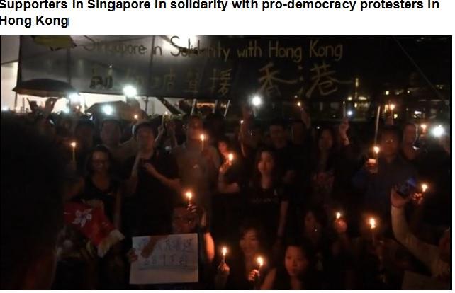 大约400位新加坡人和港人点蜡烛在芳林公园声援香港占中民主运动 - 时事沙龙 - 随笔南洋网 新加坡华文论坛